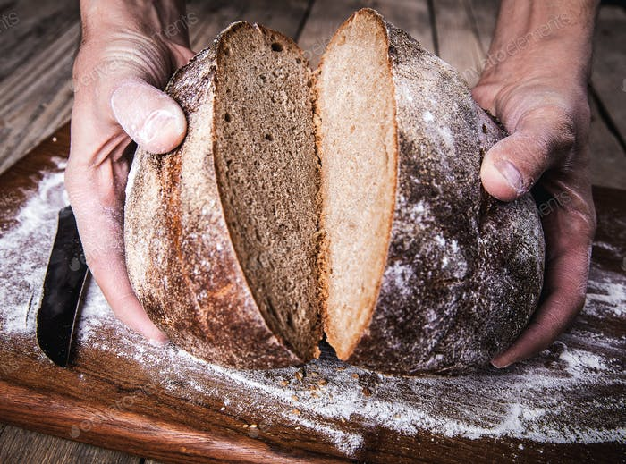 food. rye bread in male hands