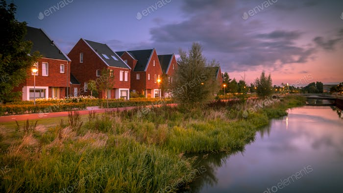 Modern ecological suburban street at night