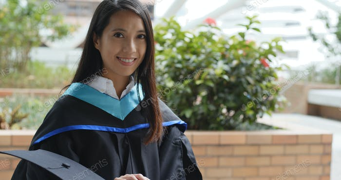 Young asian woman graduated from university