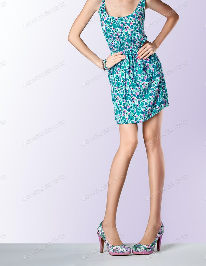 Woman in fashion floral dress, high heels, outfit