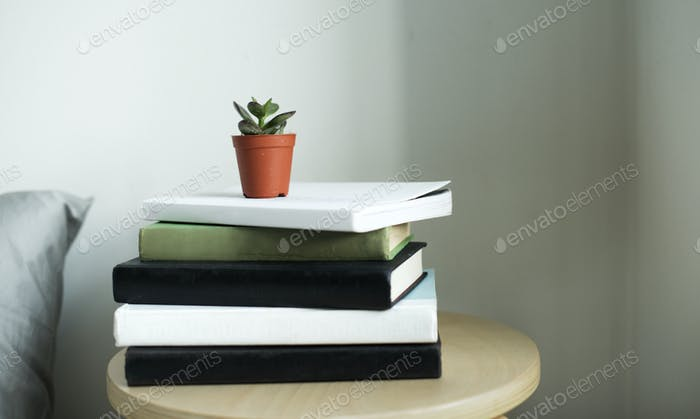 Closeup of books stacked on wooden table