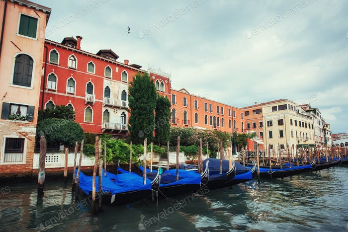 City landscape. Green water with gondolas and colorful facades o