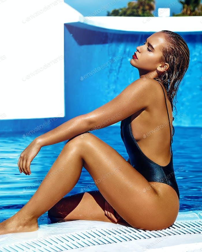 beautiful girl model with dark hair in black swimwear
