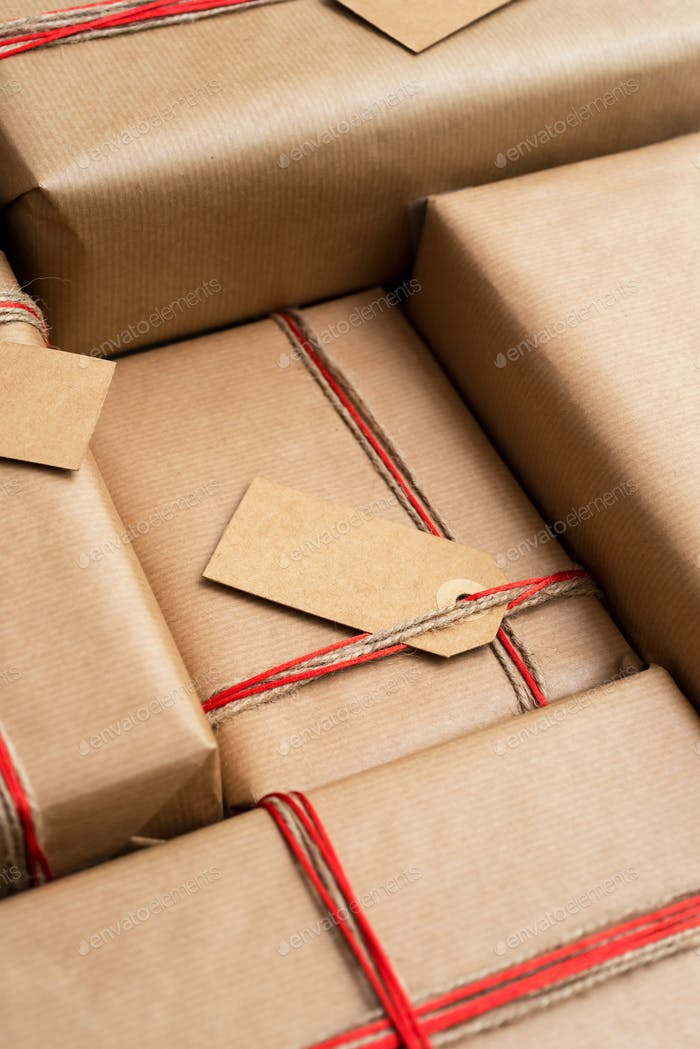 Stack of craft gifts wrapped in recycled paper
