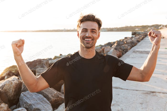 Portrait of a cheerful sportsman celebrating success