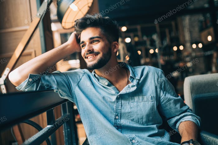 Portrait of young handsome man in blue shirt