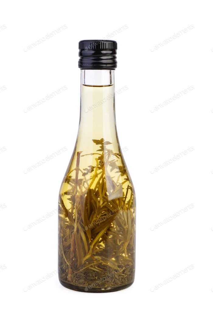 Bottle with apple vinegar and herbs isolated on the white background