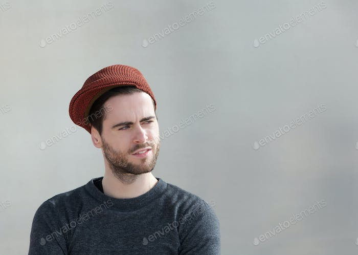 Cool guy with hat looking away
