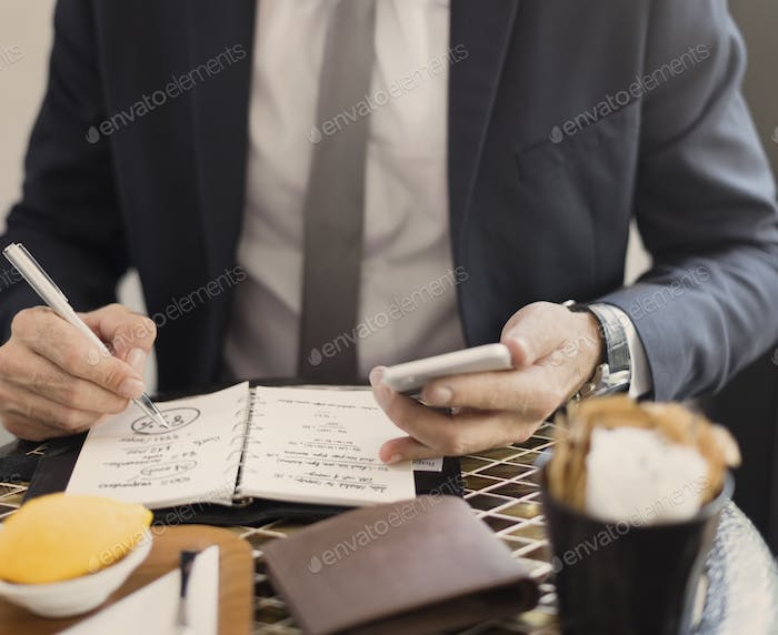 Cropped Businessman Writing Notes Journal Concept
