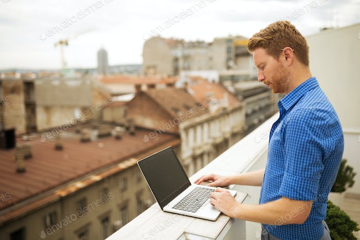 Businessman working on rooftop