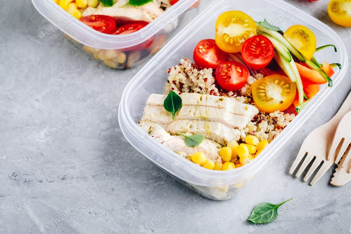 Meal prep containers with quinoa, fresh vegetables and chicken
