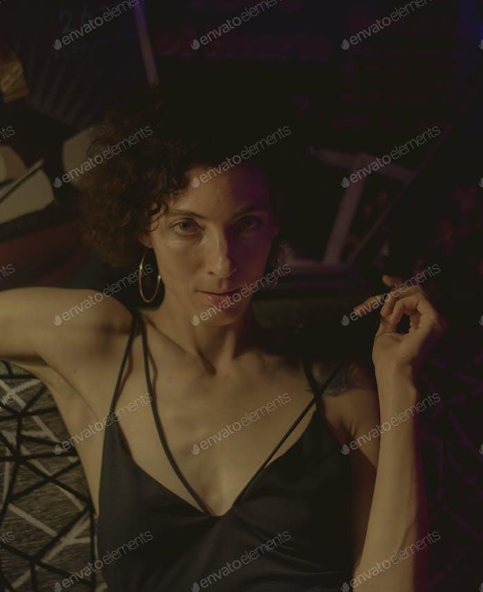 Portrait of a woman in a dark bar