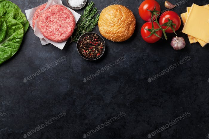 Raw minced beef meat and ingredients for burgers