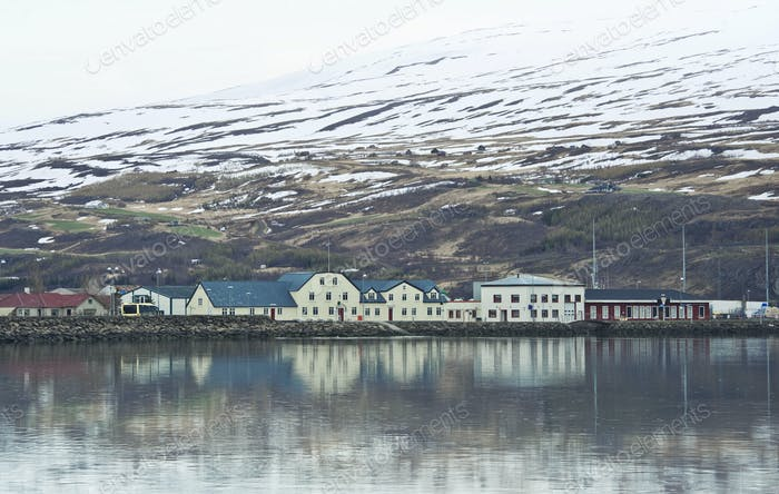 Iceland village city in mountains on field
