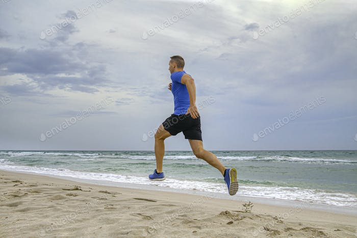 man runner in blue shirt and black shorts