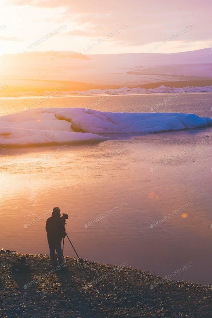 Tourist make photo in glacier