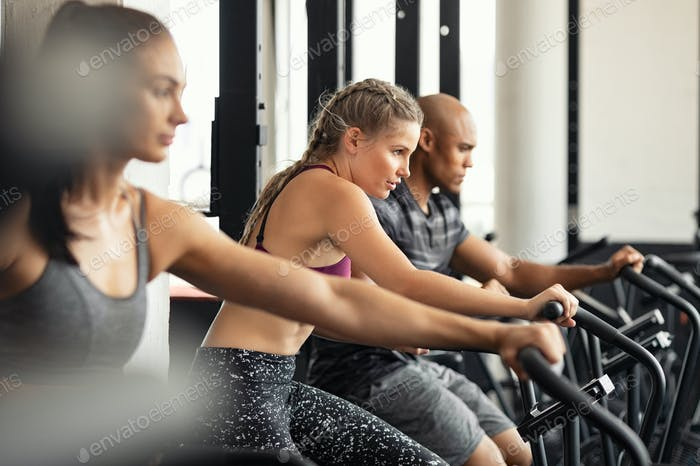 Fitness group training hardly on cycling machines