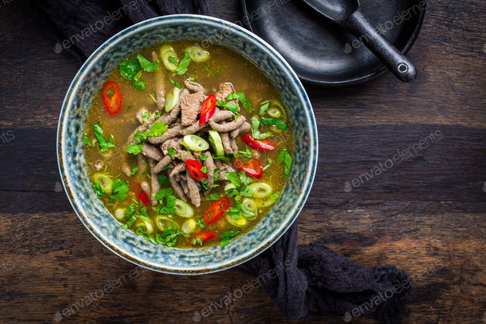 German liver dumpling soup with onion and vegetable