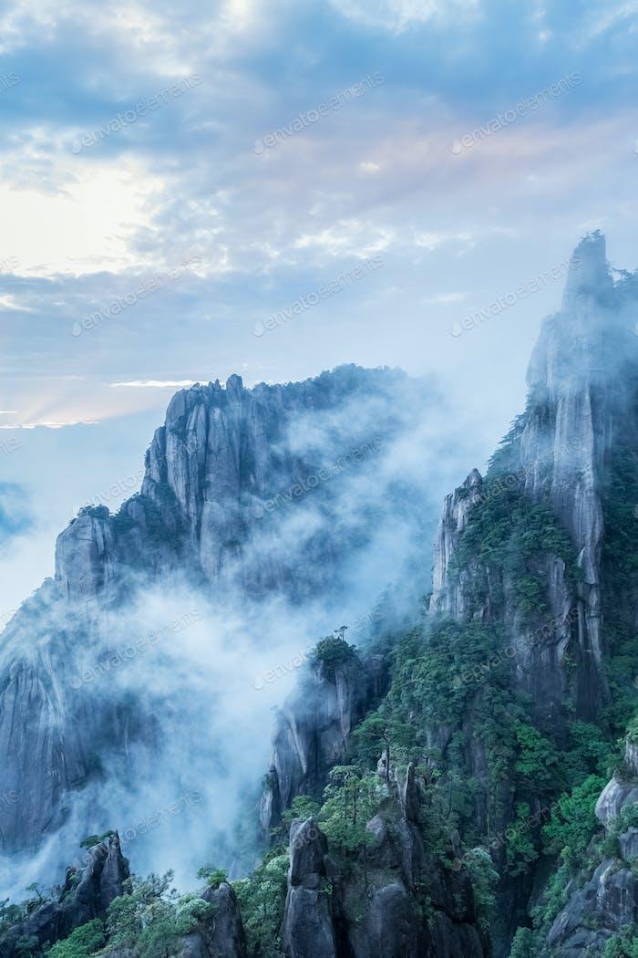 beautiful granite pillars and peaks in cloud fog