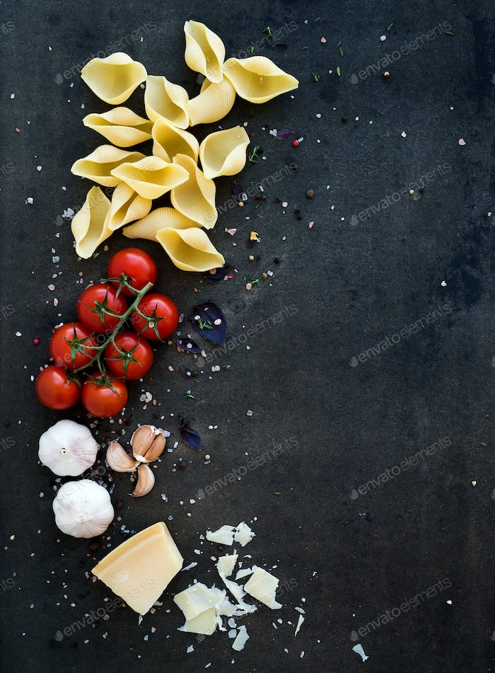 Food frame. Pasta ingredients. Cherry-tomatoes, pasta, garlic, basil, parmesan