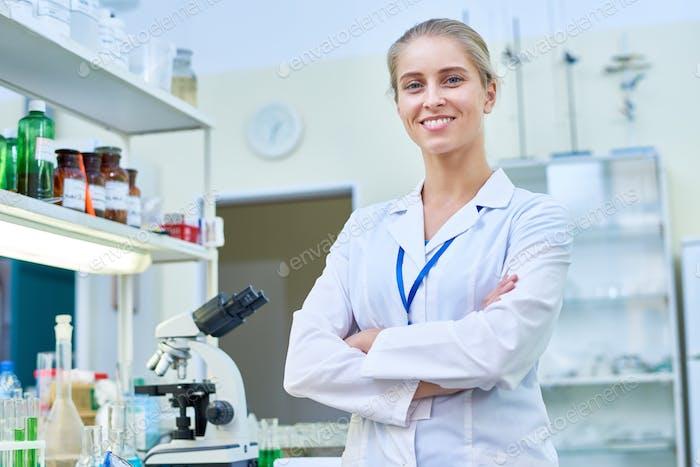 Cheerful Female Scientist in Lab