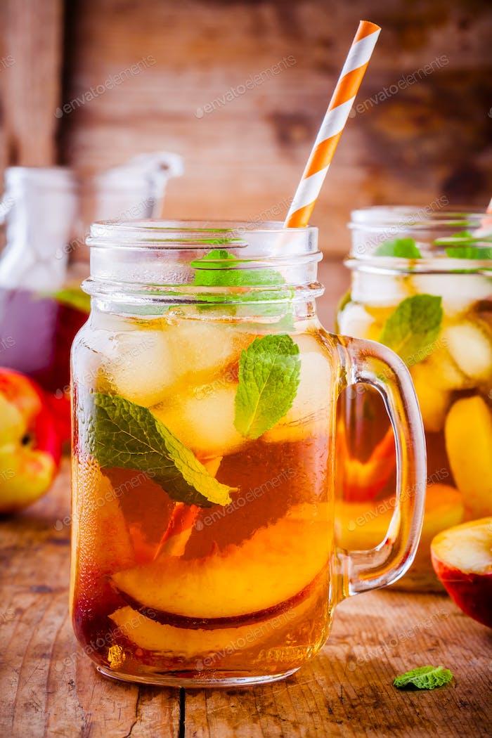 Peach ice tea in mason jar with mint