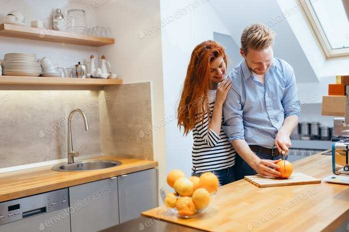 Happy couple making organic juice