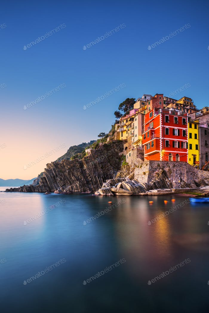 Riomaggiore town, cape and sea landscape at sunset. Cinque Terre