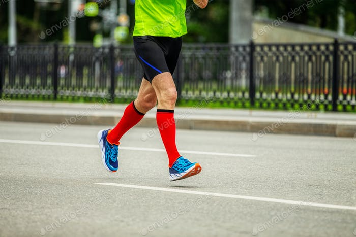 male runner in bright red compression socks