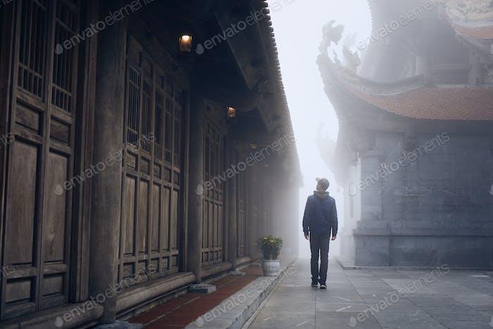 Traveler in mysterious fog