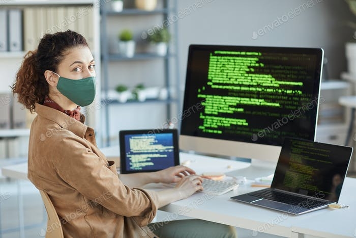 Programmer coding in an office