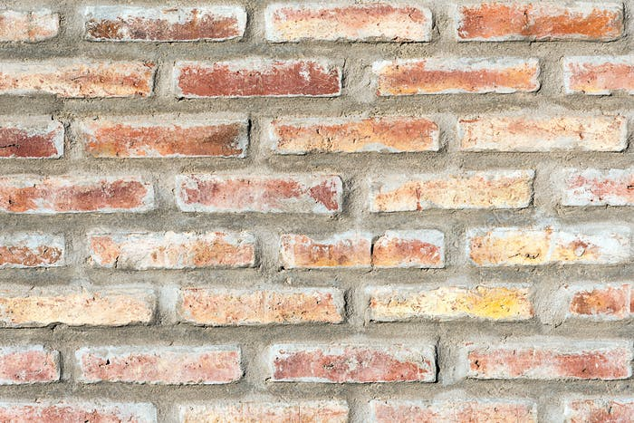 Hintergrund aus einer roten, robusten Mauerwand