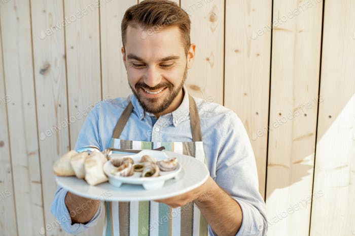 Waiter with stuffed snails