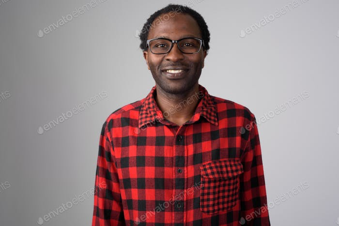 Portrait of happy African hipster man smiling with eyeglasses