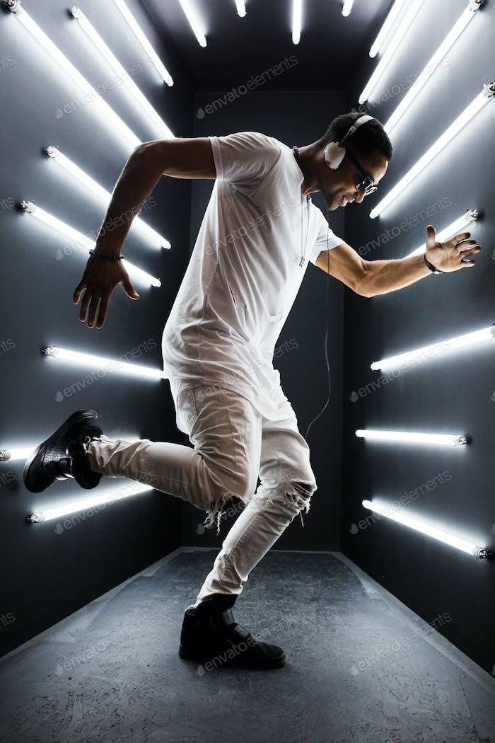 black man dancing in neon lights