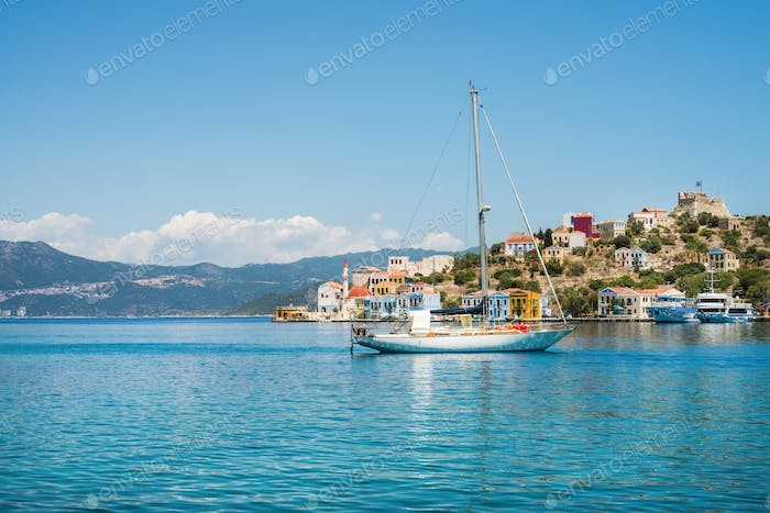 Yacht in bay of Kastelorizo island, Dodecanese, Greec