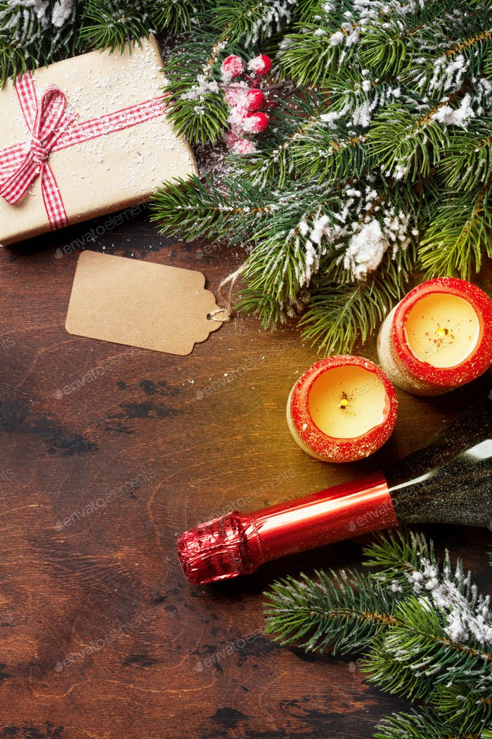 Christmas gift box, candles, champagne