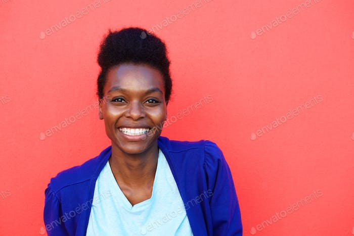Attractive young african female on red background