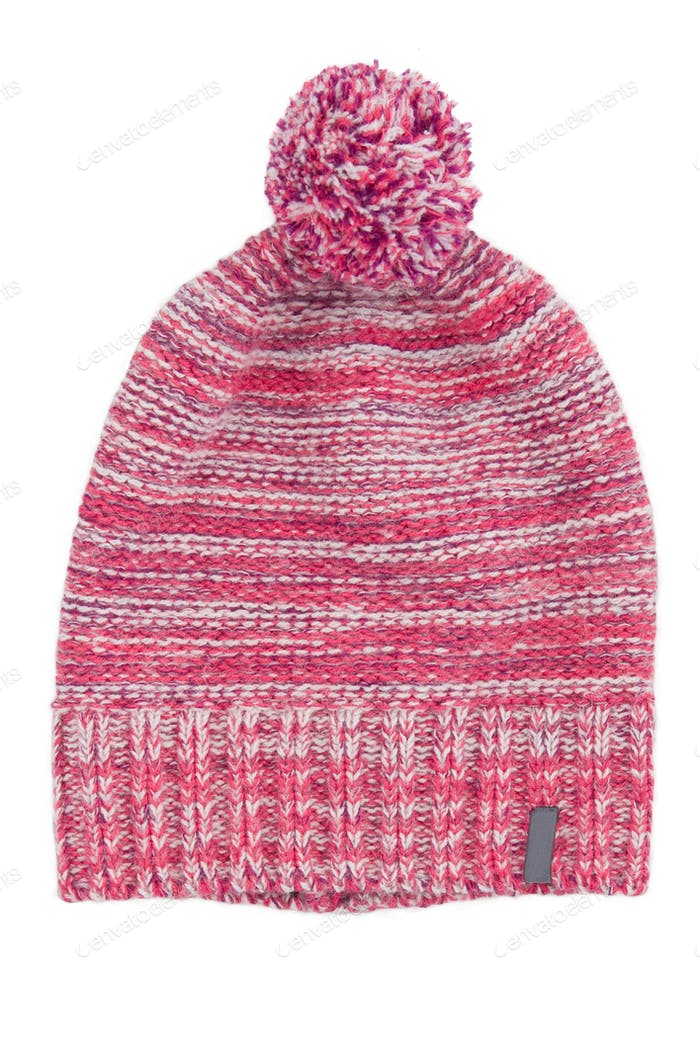 Pink woolen cap with a pompon. Isolated.