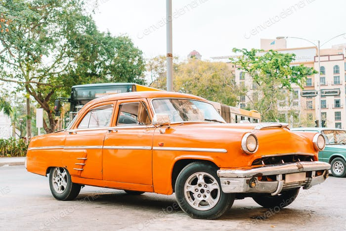 View of yellow classic vintage car in Old Havana, Cuba