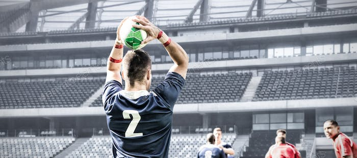 Digital composite image of rugby player throwing the ball in sports stadium