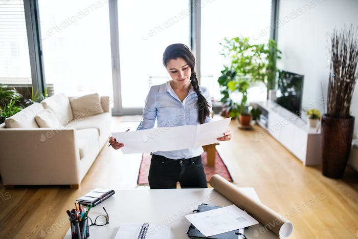 A portrait of a woman working at home.
