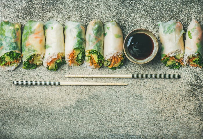 Flat-lay of vegan spring or summer rice paper rolls