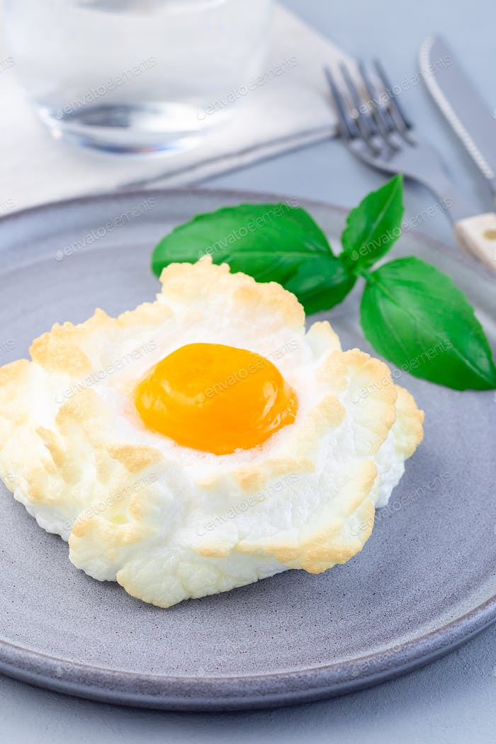Oven baked cloud or fluffy egg dish on  gray plate, vertical