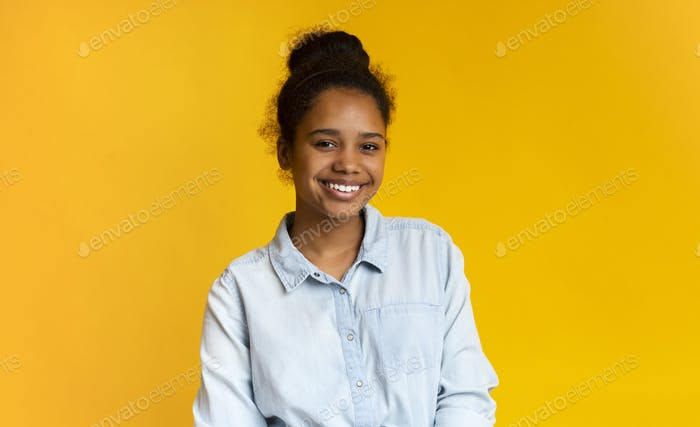 Portrait of cute african american girl smiling to camera