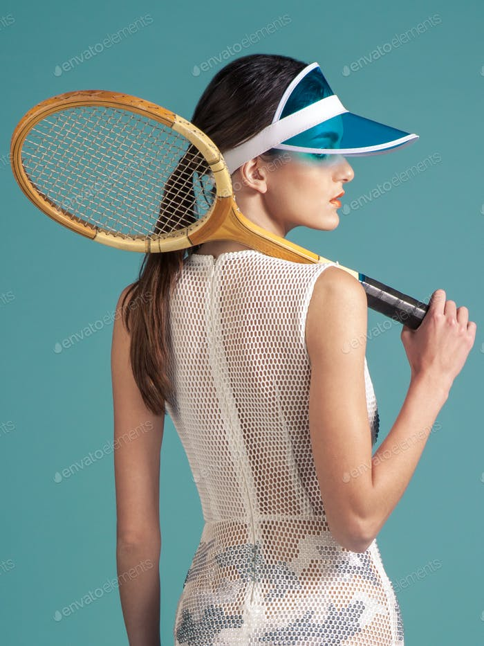 sporty woman tennis player with tennis racquet on blue background