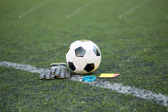 Thumbnail for ball, gloves, whistle and cards on soccer field