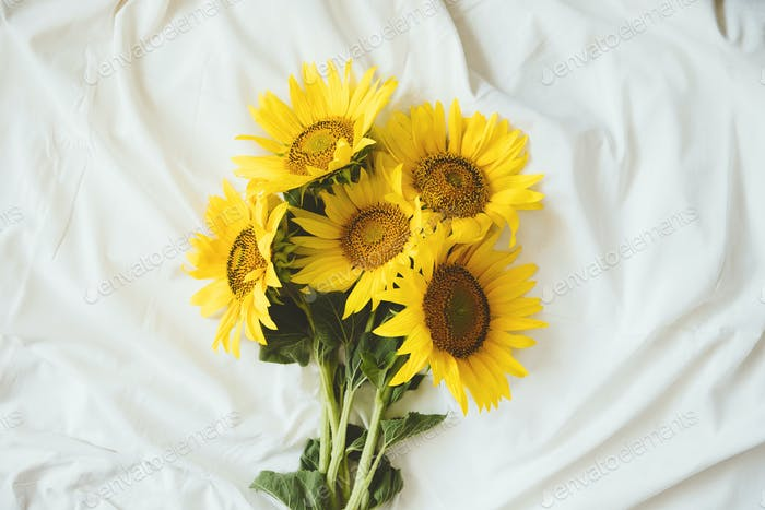 Candid authentic Yellow sunflowers bouquet on fabric