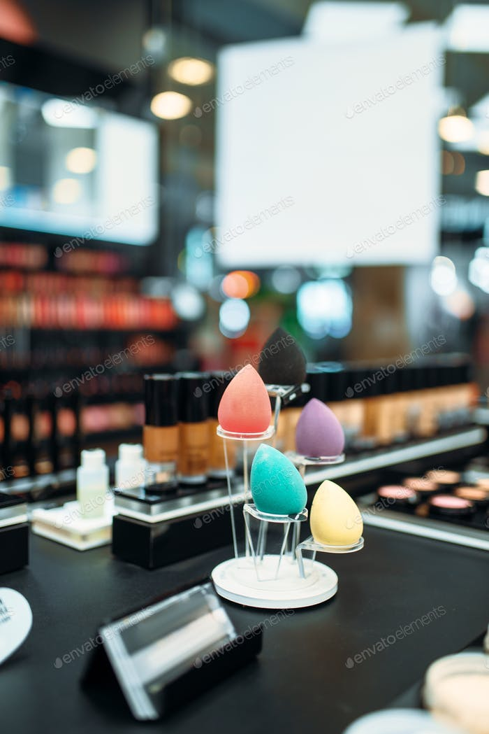 Make-up cosmetic collection in beauty shop closeup