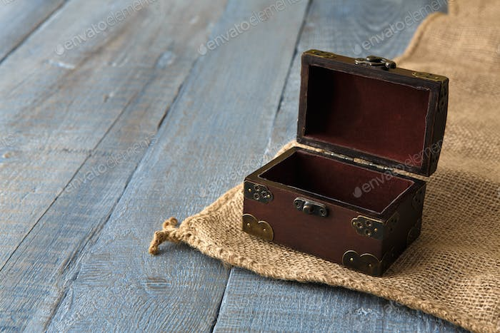 Wooden chest or trunk at serenity wood background